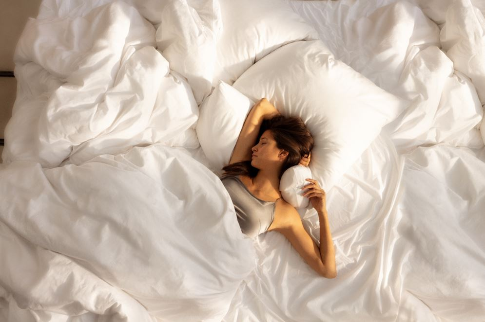woman dreams sleeping on white sheets